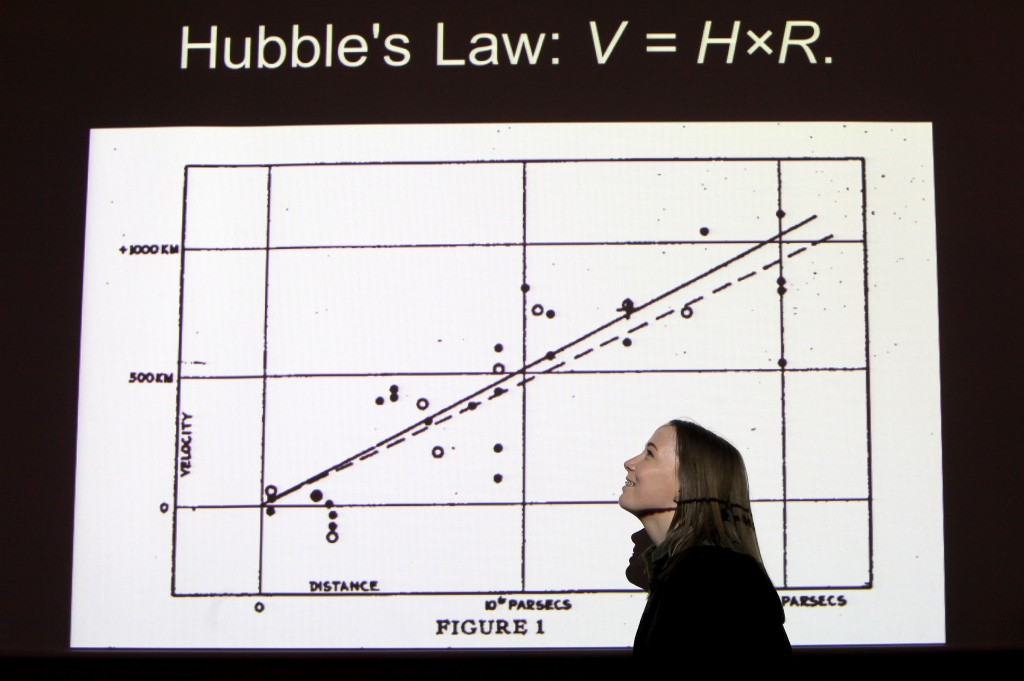Students from the 'Tyneside STEM Scholar Programme', who are part of the 'Reece Foundation' programme visit the 'Centre For Life'....Louise McIntyre at the Hubble workshop with a graph of 'Hubble's Law'