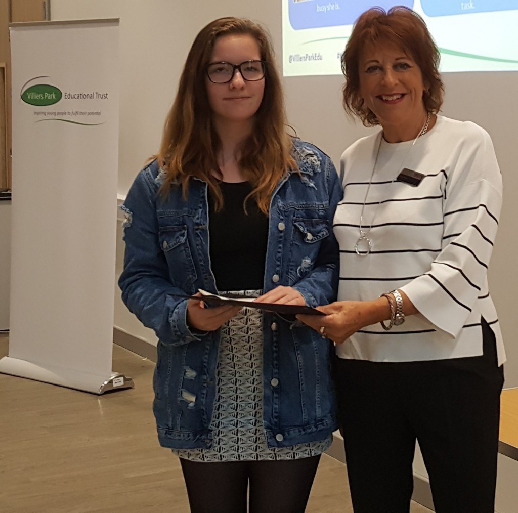 Mike Baker Year 12 Scholar of the Year, Rebecca Cather of Excelsior Academy, receives her award from Anne Reece, chair of the Reece Foundation