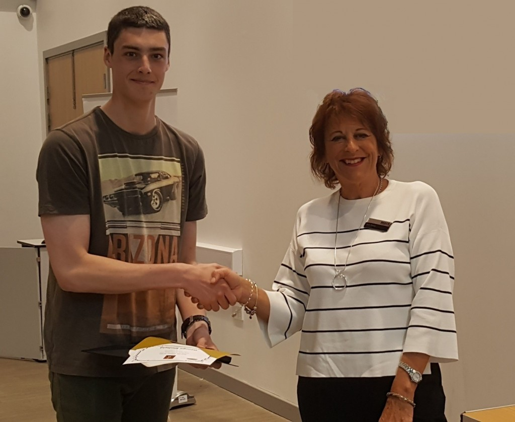 Mike Baker Year 13 Scholar of the Year, George Binfield of Longbenton High School, receives his award from Anne Reece, chair of the Reece Foundation